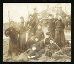 1907 I. I. & C. volleyball team with child mascot